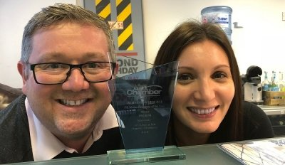 John and Sam show off their PR company of the year trophy